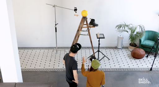 Rachel Gulotta and Daniel Inskeep, Skillshare instructors and photographers at Mango Street Lab, set up props for their photoshoot.