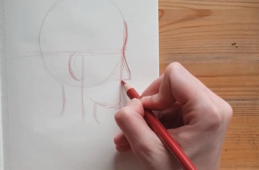 Adding in the nose and mouth first helps you to figure out where the eyes should be positioned, as shown by Skillshare teacher Gad Ounelfe.